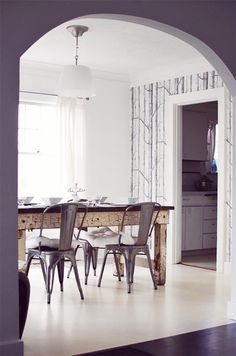 I love Nubby Twiglet's dining room. Wood, metal, white, wallpaper forest