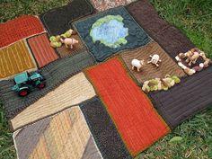 Farm Play Mat made from upholstery, denim, corduroy, and textured fabrics.  Love the farm animals (anamalz brand)