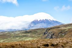 The deep valley on Rumiñahui above the Hacienda El Porvenir and the cliff where the Andean condors nest.  In the distance, Cotopaxi volcano is visible in Ecuador.