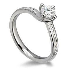 Diamond shoulder, round cut twist engagement ring.  Available at www.diamondsandrings.co.uk