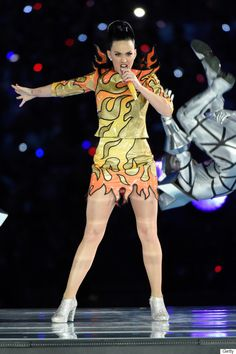 Katy Perry's fiery first look for Super Bowl XLIX... haha. * I love her but enjoyed Missy so much more!  Best part off her performance was the cute dancing sharks!  :)