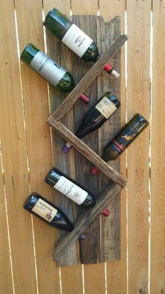 bottle wine rack made from recycled fence. This wine rack is made from a 20 ye. 6 bottle wine rack made from recycled fence. This wine rack is made from a 20 bottle wine rack made from recycled fence. This wine rack is made from a 20 ye. Wooden Pallet Projects, Wooden Pallets, Diy Projects, Barrel Projects, 1001 Pallets, Vin Palette, Modern Wine Rack, Wood Wine Racks, Pallet Wine Racks
