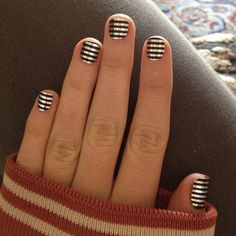 Wow this is so pretty. I love the metallic stripes nails.
