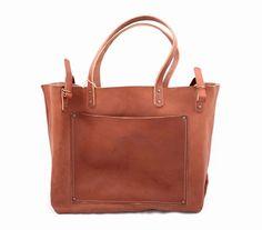 Apron denim fabric. Bridle leather straps and pocket....
