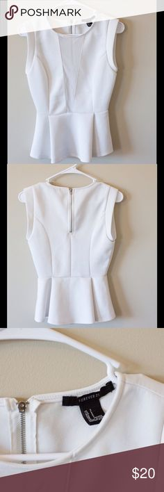 Forever21 peplum top Forever21 white peplum top with sheer triangle in the front. Zipper enclosure in the back, no obvious damage but slight pilling on the back Forever 21 Tops Blouses