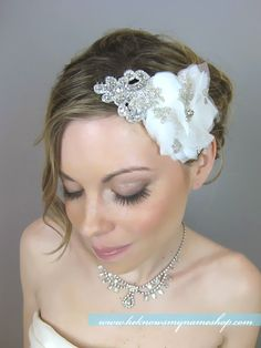 This is a pretty headpiece. I also love the hairdo.