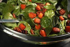 Warm Spinach Salad with Smoky Pecans and Sweet Potato  (Smoked paprika coats warm toasted pecans.)
