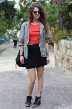 Tel Aviv Street Style: Cropped top, mini skirt, and sneakers