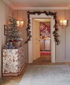 A classic Indienne print table cover by @linwood_fabric edged with a wide, striped border acts as a lively foil for the plain walls and floor of this entrance hall... --- #Christmasdecorations #festive #interior #hallway styling Katrin Cargill and Sarah Robertson, photograph by Jan Baldwin