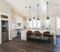Vaulted Ceilings In The Kitchen Large Island With Pendant Lighting And Wooden Bar Chairs