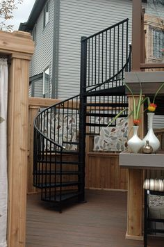 """The spiral staircase from """"Decked Out"""" episode """"The Spiral Staircase Deck"""". Deck Design by Paul Lafrance Design."""