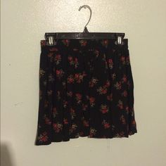 Brandy Melville Skirt, NWT only worn once! Red and green floral print on black. Super good condition! Really pretty but it didn't suit me. No stains, tears, ect. Brandy Melville Skirts Midi