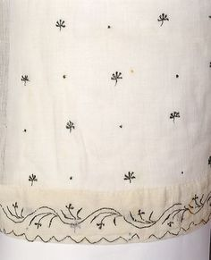 Evening dress, that consists of white Indian muslin, embroidered in silver thread, 1805