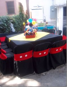 Easy Mickey Mouse Party Look with Black Chair Covers and Red Chair Bands