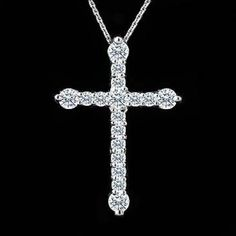 This beautiful g cross pendant is made of solid k white gold and contains round brilliant cut diamonds smaller and larger in the total weight of Ct G-H color and Diamond Cross Necklaces, Diamond Pendant Necklace, Diamond Jewelry, Gold Jewelry, Jewelery, Quartz Jewelry, Bridal Jewelry, Cross Jewelry, Champagne Diamond