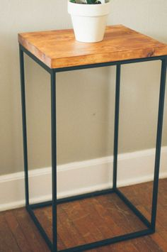 ikea hack - making a side table. Use metal frame from ikea laundry basket. Cut & stain a piece of natural wood for table top. Paint metal frame stainless steel, copper or....