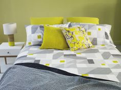 Pops of zingy yellow in the Rukin duvet cover matches the Tub table lamp and Tatsuma bedside table #Habitat