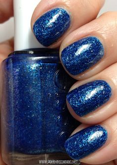 Essie. Lots of Lux with topcoat. Encrusted Treasures Collection 2013. -Blue with blue glitter Swatch from: polishinsomniac.net