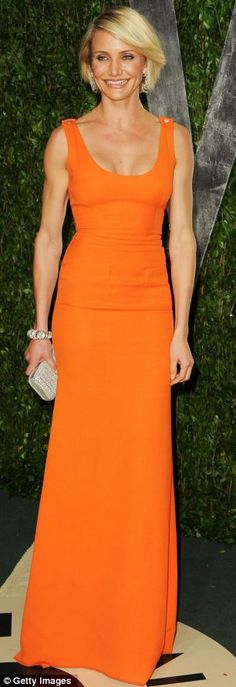 Her arms absolutely scare me but I love the orange dress! That would like nice with a good tan...