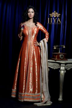 The Zohra Laccha with trails of dull gold flower motifs embossed for brocade like elegance. Pakistani Party Wear Dresses, Indian Gowns Dresses, Indian Party Wear, Stylish Dresses, Elegant Dresses, Pretty Dresses, Fashion Dresses, Marriage Suits, Silk Kurtas