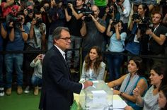President of Catalonia Artur Mas casts his at a polling station on September 27, 2015 in Barcelona, Catalonia. The main Catalanist parties, Catalan Democratic Convergence 'Convergencia Democratica de Catalunya' party (CDC), Republican Leftist of Catalonia 'Esquerra Republicana de Catalunya' party (ERC) and a group of social associations have joined together to form a Catalan pro-independence coalition 'Junts pel Si' (Together for the Yes).