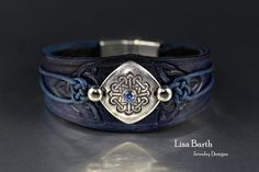 Hand made leather bracelet with a fine silver centerpiece. I tooled, dyed and finished the leather to go with the silver. https://www.etsy.com/shop/LisaBarthJewelry?ref=hdr_shop_menu