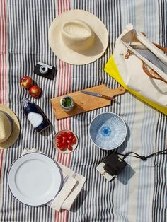 We're so craving a power picnic. On our wish list isvintage suitcasesand cool basketsfor carrying the food, bright colored pillows and poufs for seats, turkish towels as blankets and tablecloths, wine bottle tumblersand fun glassware, wood traysand coolers, sturdy canvas totesand backpacks, air plant centerpieces, and of course the bike rides to and from the outdoor fun.