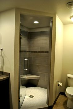 Custom shower with bench and accent of subway tile