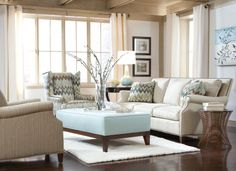 Soothing blue and earthtones make this @huntingtonhouse living room a cozy retreat.
