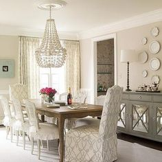 Gray Mirrored Sideboard Under Decorative Wall Plates, Transitional, Dining Room
