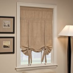 To replace vertical blinds (would take slats down, maybe leave hardware up?).  Better alternative to curtain panels, which would get dirty in the kitchen.  Leaving them rolled up part way would give some privacy while letting the cats see out.  And it would look cool with a runner on the floor with similar colors.
