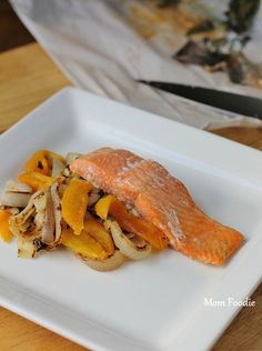 Lemon Balm Salmon cooked in parchment, served over a mixture of grilled sweet onions & roasted yellow peppers.