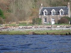 Gracie's Cottage, a traditional detached holiday cottage on the shores of Loch Kishorn in the small village of Achintraid. A perfect west coast retreat. Holiday Cottages In Scotland, Cottages Scotland, Wester Ross, Stone Cottages, West Coast, Places To Go, Cabin, House Styles, Plants