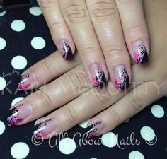 Very elegant pink and black sculpted gel nails with some free hand art.  Done here at www.allaboutnails.org