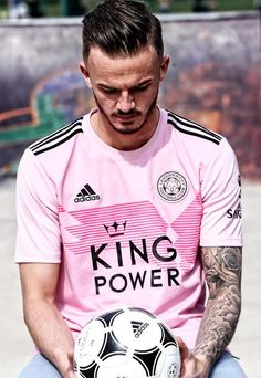 This is Leicester's pink away jersey for the season. In an unseen move for the club, the Leicester third jersey is pink, with the logos and details appearing in black, including a pink-black club crest on the left chest. Leicester City Football, Leicester City Fc, James Maddison, Germany Shirt, Jersey Outfit, Premier League Champions, Football Outfits, National Football Teams, Football Kits