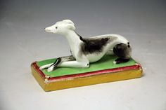 Staffordshire figure of a whippet on base, antique period circa 1840
