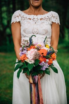 bouquet with green and orange - photo by The Melideos http://ruffledblog.com/romantic-wedding-in-the-berkshires #weddingbouquet #flowers