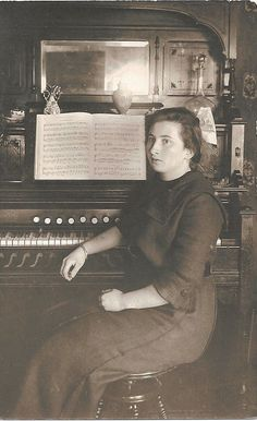 https://flic.kr/p/8rZH5e | Young woman with reed organ | This postcard photograph is dated January 8, 1918,  with the inscription--to Ezra Elbur from sister Clara.