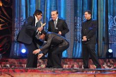 True-Indian-Values: @iamsrk touches @SrBachchan 's feet at #StardustAwards