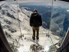 The glass observation box at Aiguille du Midi in Chamonix, France hangs in mid-air.
