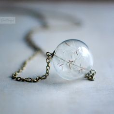 A necklace with dandelion fluff inside ...always carry a wish with you...