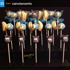 Awesome monkey cake pops displayed in a 3-tier collapsible black cake pop stand