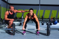 woman crossfit training with trainer