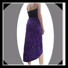 $ 12 Purple Black Dress/Skirt NWT Purple and Black Convertible Dress/Skirt NWT. Tag says extra-large, however, review measurements.  More like medium/large. Top hem measurement, lying flat, not stretched is 14 inches. Length in front is 31 inches and in back is 39 inches. NWT. This versatile adorable dress can be worn as a dress or skirt which gives you two different looks. A must for your closet. Colors are absolutely vibrant.🔴Please ask any questions before purchasing. Not returnable if…