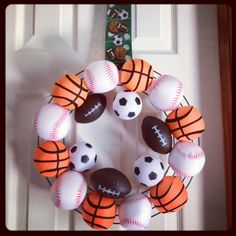 Sports wreath 🏈🏀⚽⚾ makes a great gift 🎁 Sports Theme Classroom, Sports Theme Birthday, Baseball Wreaths, Sports Wreaths, Baby Shower Cakes For Boys, Decorating Ideas, Craft Ideas, How To Make Wreaths, Door Hangers