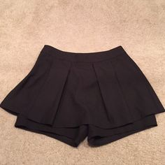 Black super cute skorts (skirt shorts) Never used. No tags. Great for showing some skin, versatile. Shorts Skorts