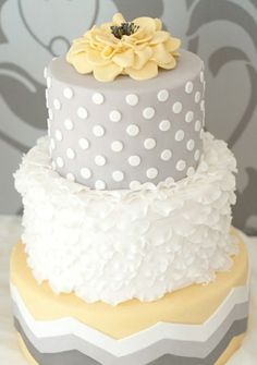 Provide a quirky yellow/gray fondant covered cake with organic ingredients and an edible cake topper. Your guests will come back for more! Yellow and Gray Wedding | Green Bride Guide