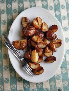 Roasted Potatoes Recipe - so easy no fail recipe..I like to use any kind of small summer potato from the garden..best if not right from the oven let sit 1/2 hour before serving as they keep their heat.I leave small potatoes whole....there are never any of these left after a dinner party. #saveur #dinnerparty