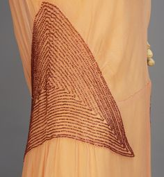 BEADED CHIFFON EVENING GOWN with CAPE, 1930's. Sleeveless sweep trained pink gown having bands of plum iridill beads at waist, shoulder, and band above the triangular open back, (no under dress). Plum chiffon floor length cape. Detail