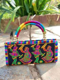 Wallets Designer Silk Kutchi Work Women's Bag  *Material* Silk   *Size* (L x B) - 9 in x 6  in   *Description* It has 1 piece of Women's Bag   *Work* Kutchi  *Sizes Available* Free Size *   Catalog Rating: ★4.1 (1156)  Catalog Name: Free Mask Kutchian Designer Handbags Vol 17 CatalogID_23458 C73-SC1076 Code: 162-229470-